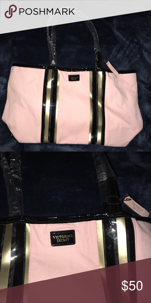 9e0b205ae0fea9 A pink, black, and gold Victoria's Secret tote bag A large pink, black, and gold  tote bag. Never been used. Victoria's Secret Bags Totes