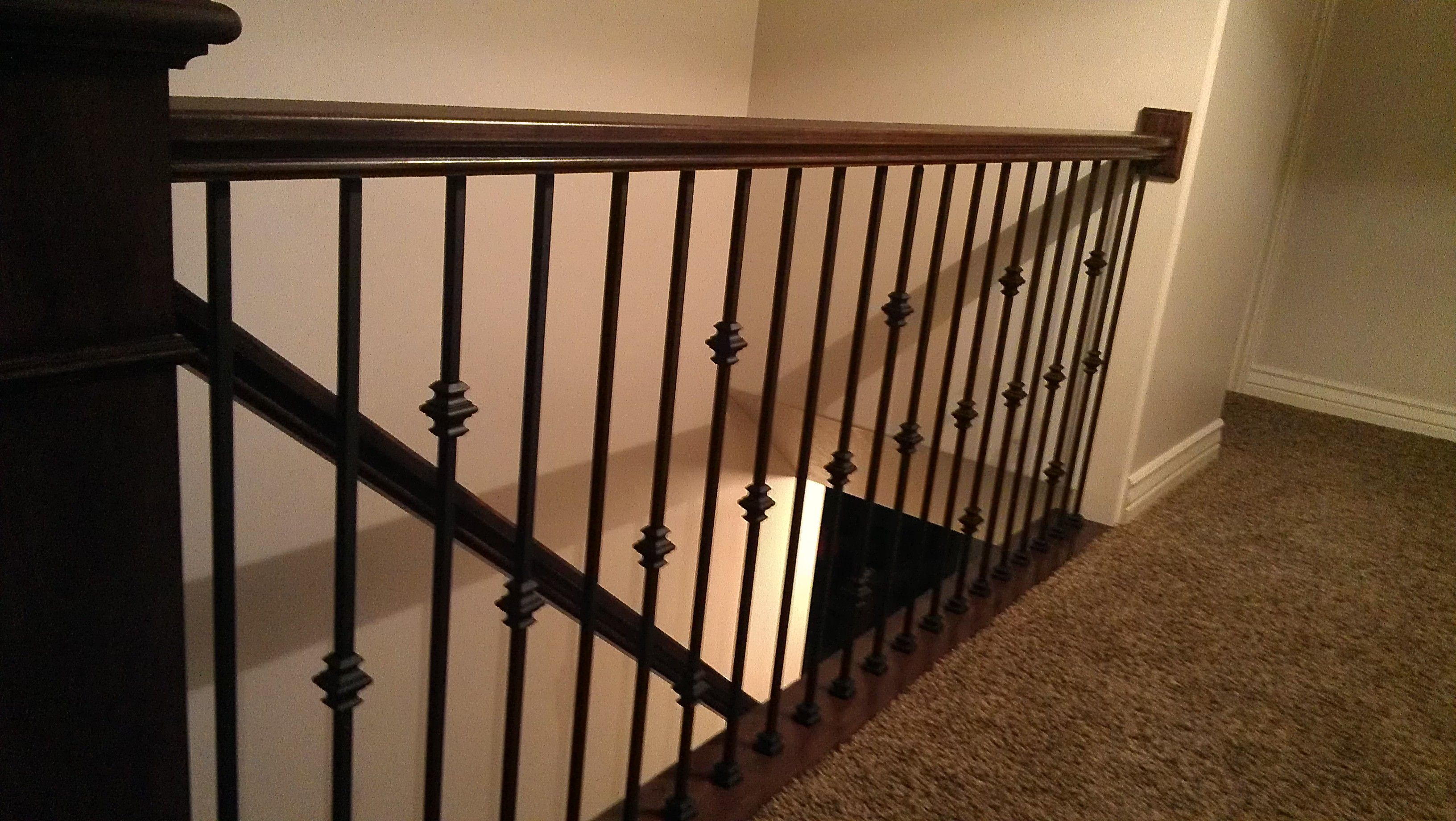 A New Cherry Stair Railing With Metal Balusters In Davis County Utah.