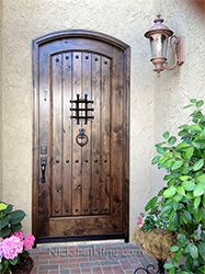 Marvelous Arched Exterior Door In Rustic Knotty Alder With Speakesy Door And Wrought Iron  Grill