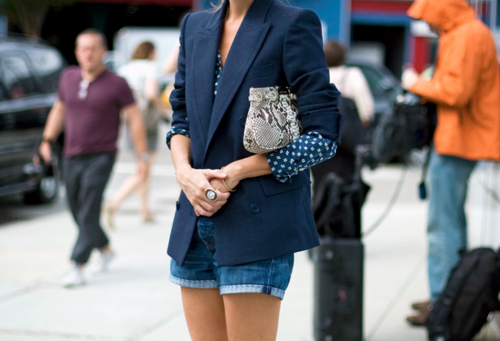 Fitted jacket over jean shorts.