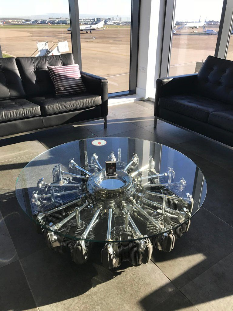 A Highly Polished Glass Top Coffee Table Fashioned From A Radial