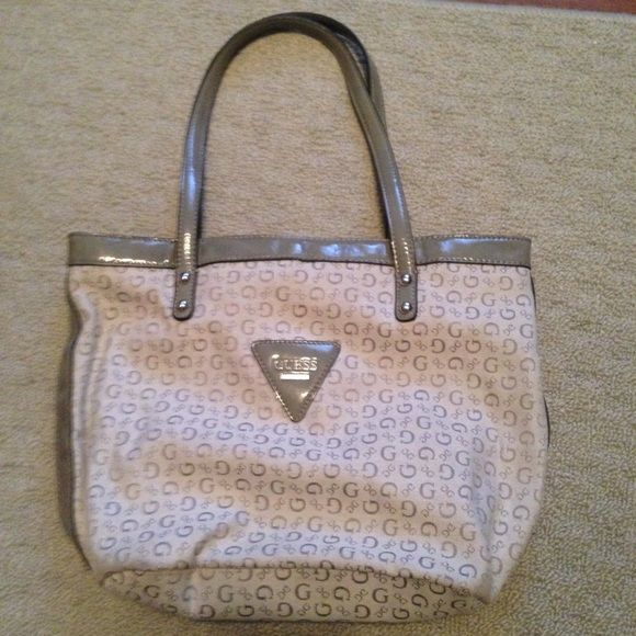 Gray Guess purse Gray canvas Guess purse.  Has been used but still in great condition. Guess Bags Shoulder Bags