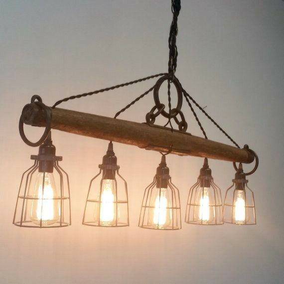 Balanced grace this modern rustic chandelier featuring five lights is crafted from a genuine antique single tree yoke