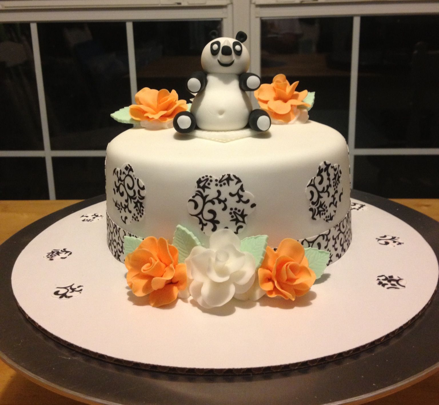 Panda cake All decorations handmade from gumpastefondant This was