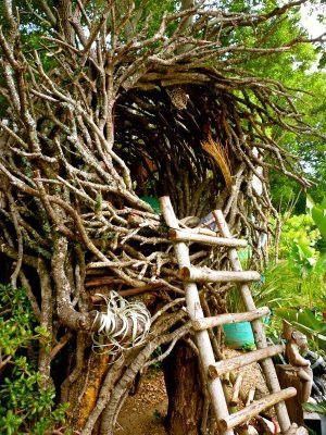tree nest made of branches twigs with rustic ladder looks like bird nest hideaway
