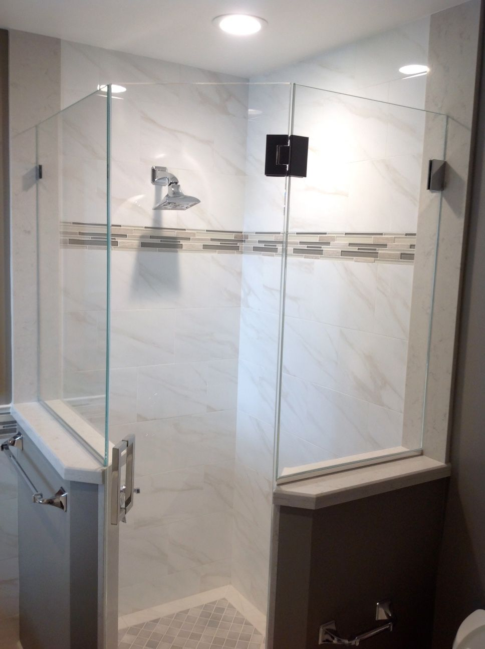Marble look ceramic tiles with a linear glass accent bathrooms marble look ceramic tiles with a linear glass accent dailygadgetfo Gallery