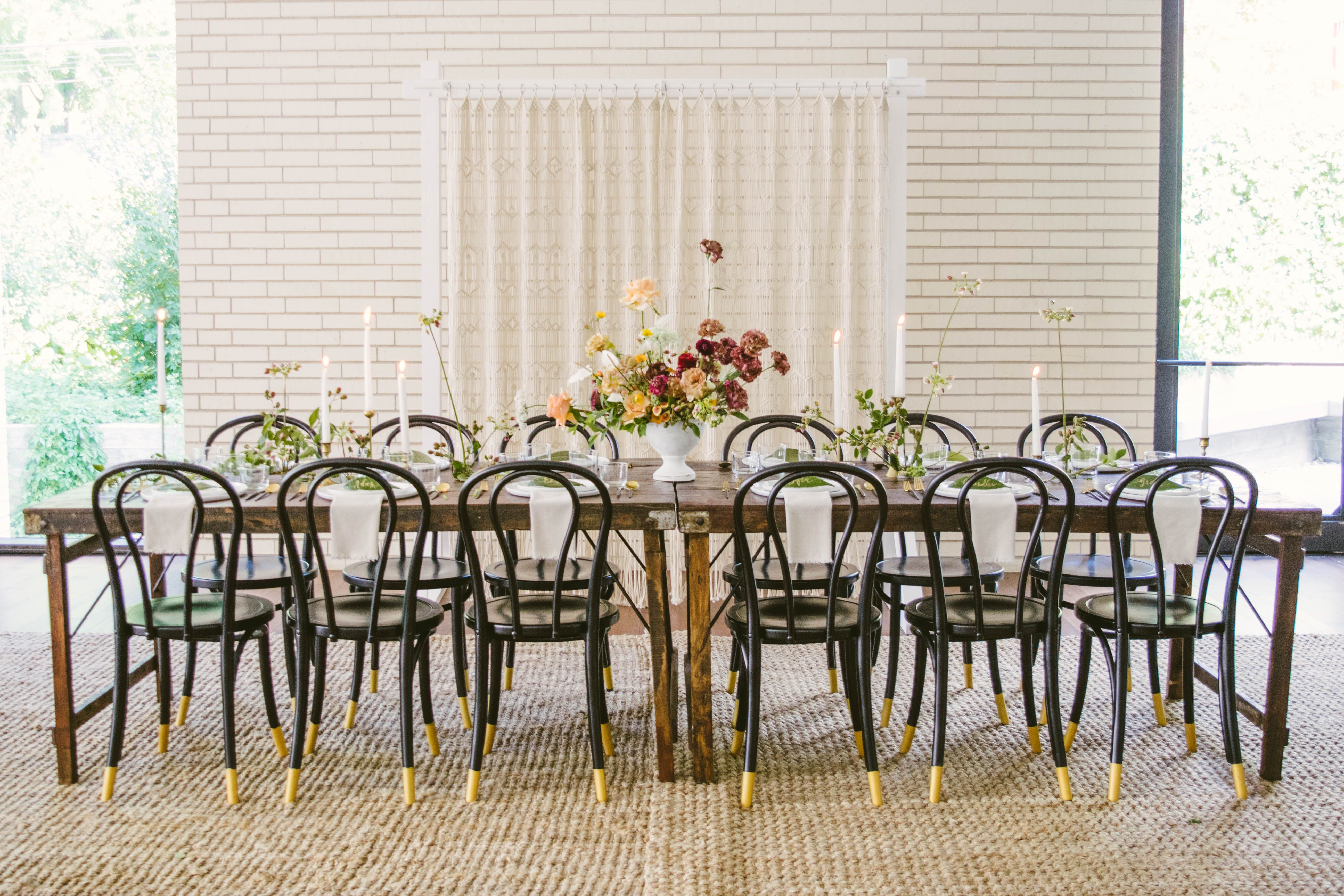 Bohemian Chic Wedding Dining Table Rustic Farm Tables With Black And Gold Bistro Chairs Over Neutral Seag Dining Table Rustic Rustic Farm Table Eclectic Rugs