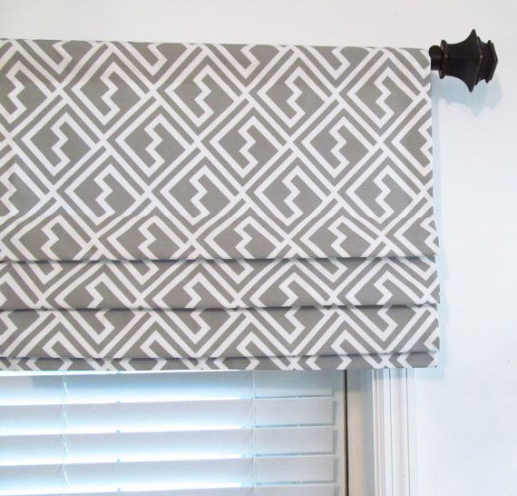 14 roman blinds on curtain poles or