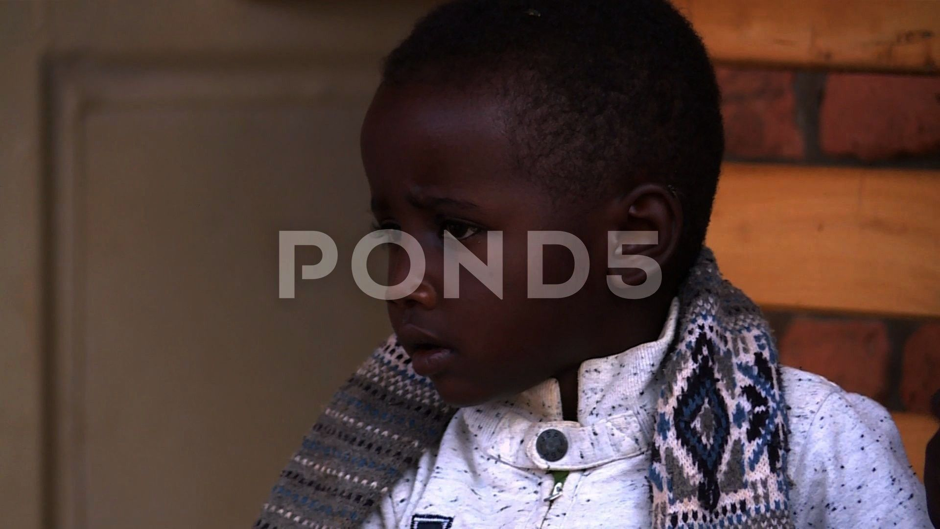 a young Rwandan sick child waiting for his medical Stock Footage RwandansickPortraityoungPortrait of a young Rwandan sick child waiting for his medical Stock Footage Rwan...