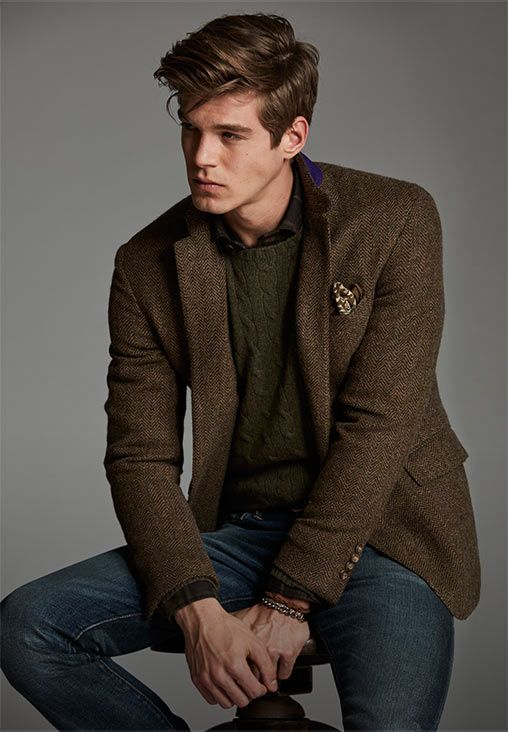 Man Layers Brown Herringbone Blazer Over Green Cable Knit