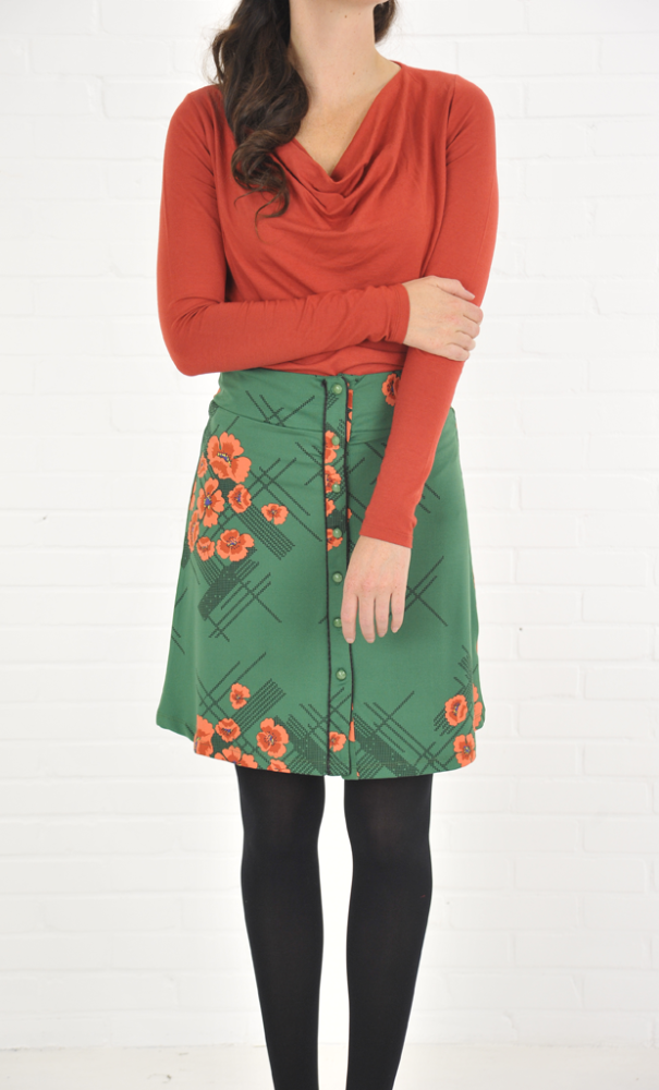 Model wears the Waterfall Top Viscose Wool Lycra with the Button skirt Quincy.