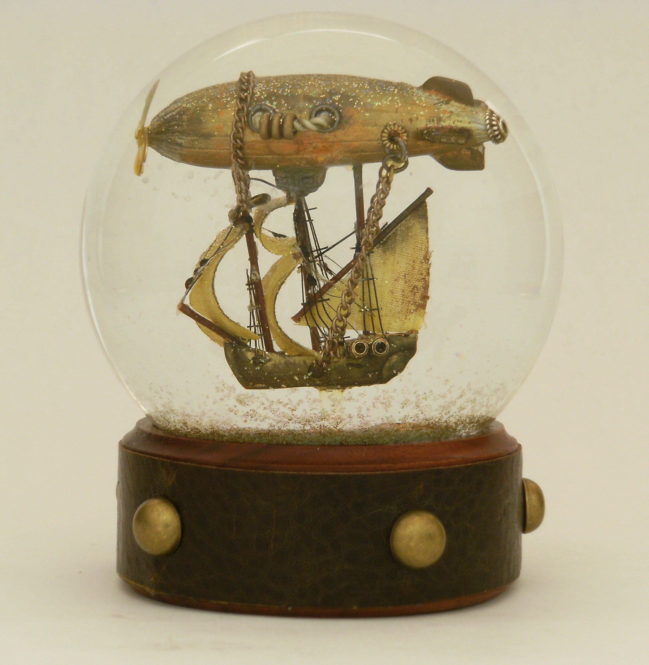 'Airship voyager',  snowglobe by Camryn Forrest.