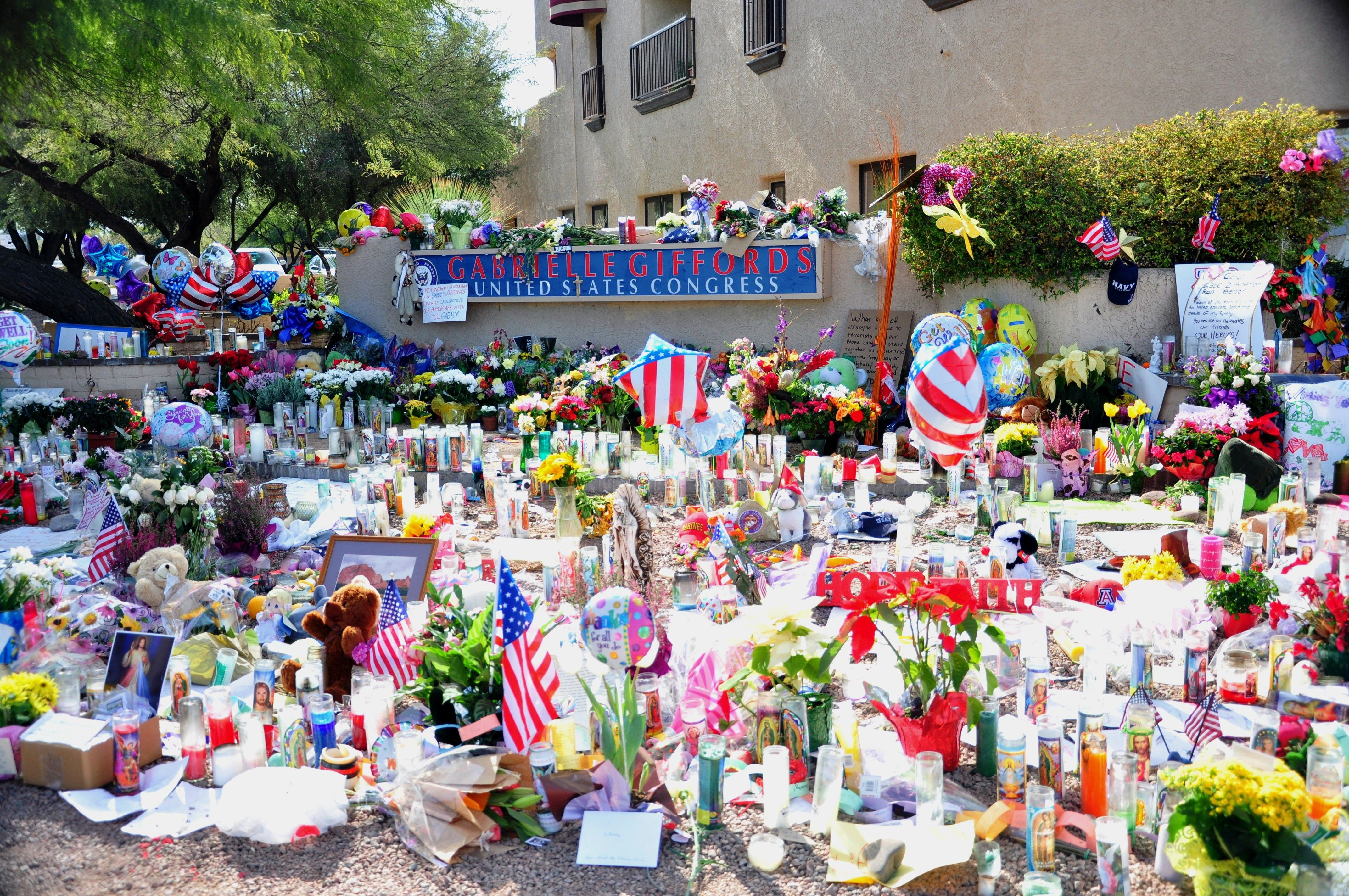 """A view of the large grassroots tribute memorial which grew up at Congresswoman Gabrielle Giffords' office after she and 18 other people were shot at her """"Congress on Your Corner"""" event on January 8, 2011 in Tucson, Arizona. Six people lost their lives in the shooting that day. Photo by Barbara Loving."""
