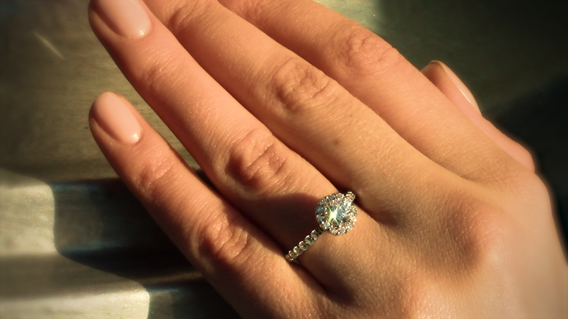 Halo ring with a diamond band for that extra sparkle effect.