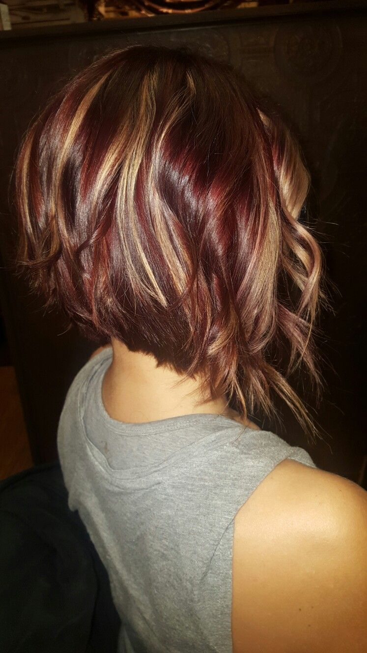 Fun red violet inverted bob with golden highlights hair
