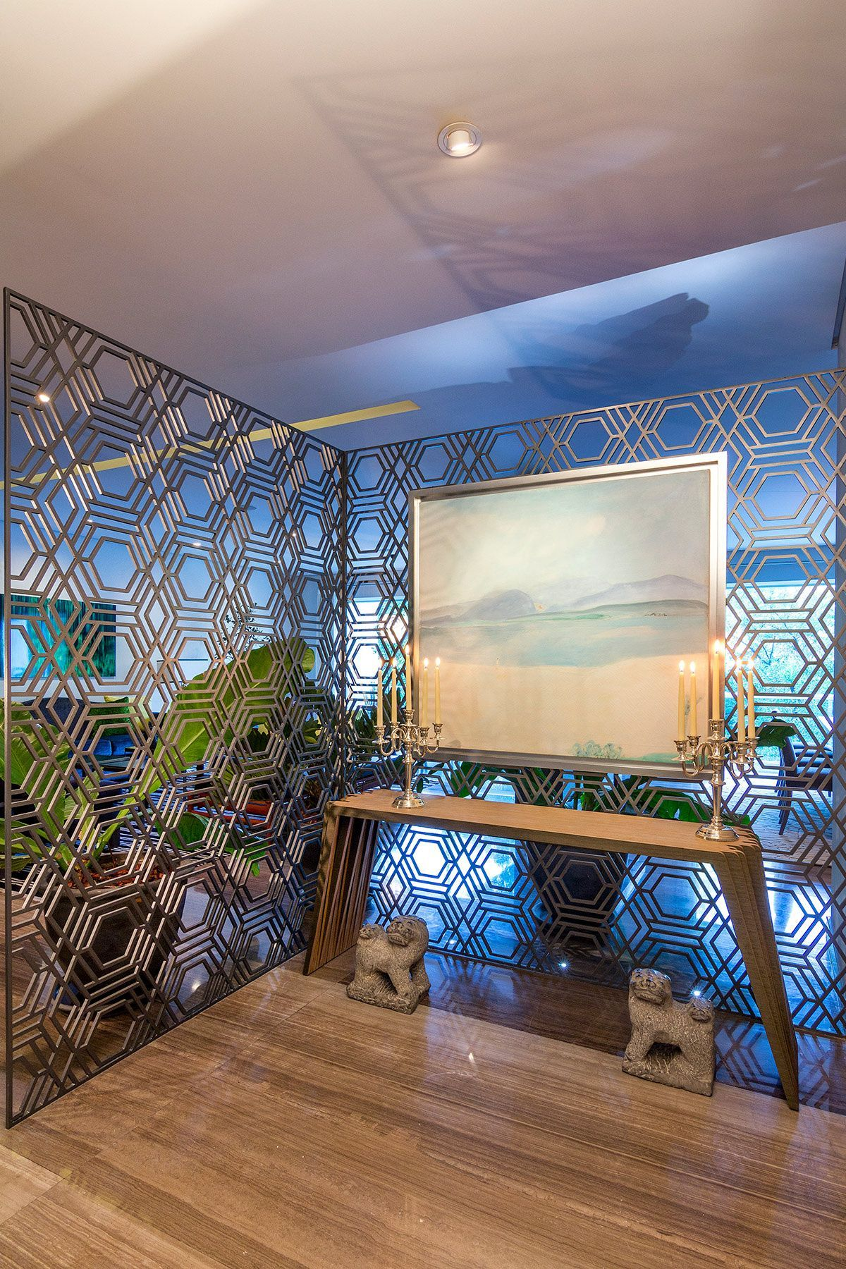 Entry is sectioned off by transparent geometric room dividers
