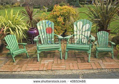 Beau Painted Adirondack Chairs By Linda Hughes, Via ShutterStock