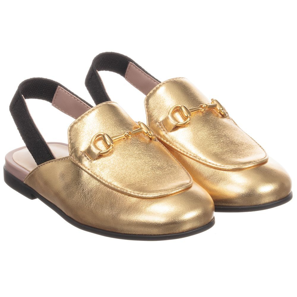f0a2fc1e6 Girls 'Princetown' loafer shoes in metallic gold leather. This slip-on  style secures with an elastic slingback and they have a gold coloured  horsebit detail ...