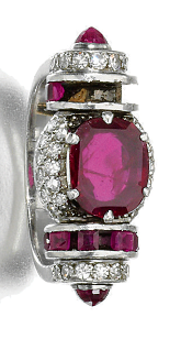 Ruby and diamond ring, 1930s. Set at the centre with an oval mixed-cut ruby, the mount of architectonic design set with calibré-cut rubies and single-cut diamonds, several small rubies deficient, size 48.