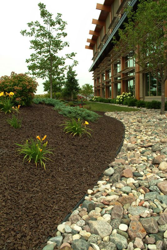 Stone And Mulch Garden Landscaping With Rocks
