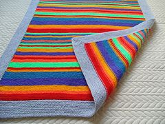 5bc1b324a966 A super simple garter stitch baby blanket with a mitred corner ...