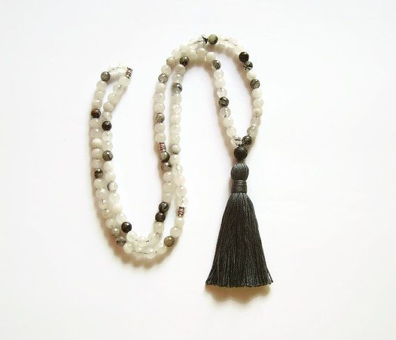 Elegant mala necklace made with faceted rutilated quartz. Each beads varies from black to clear to grey with black rutiles. Necklace has 3 markers.
