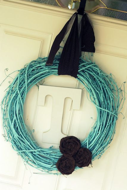 Wreath - spray paint branch/grape vine wreath, add initial, fabric strip to hang, and fabric flowers.