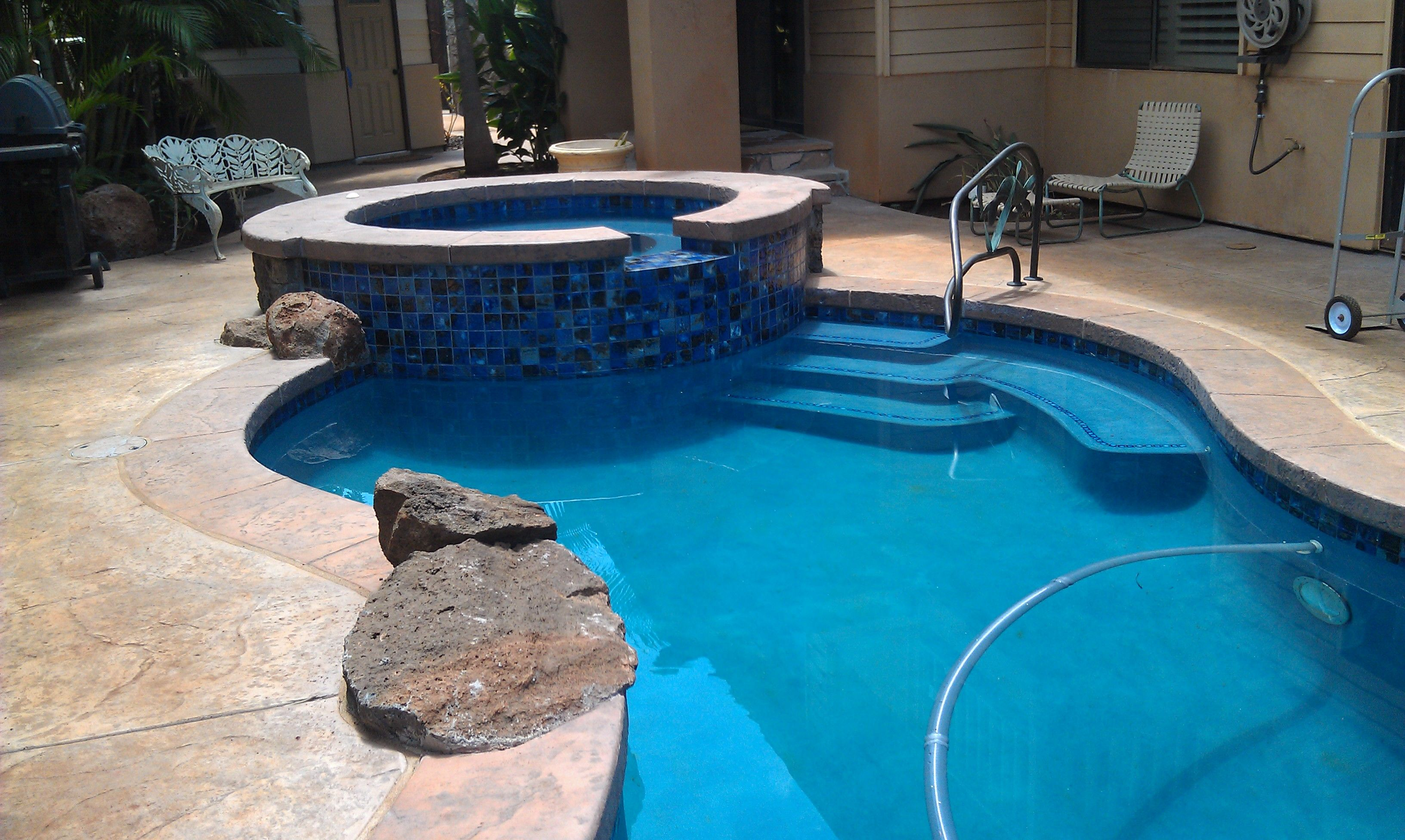 Pacific blue hydrazzo huber pool stamped concrete coping for Pacific pools