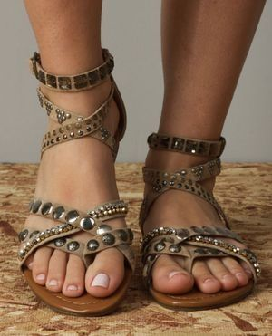 Celebrities who wear, use, or own Steve Madden Boogle Taupe Suede Gladiator  Sandals. Also discover the movies, TV shows, and events associated with  Steve ...