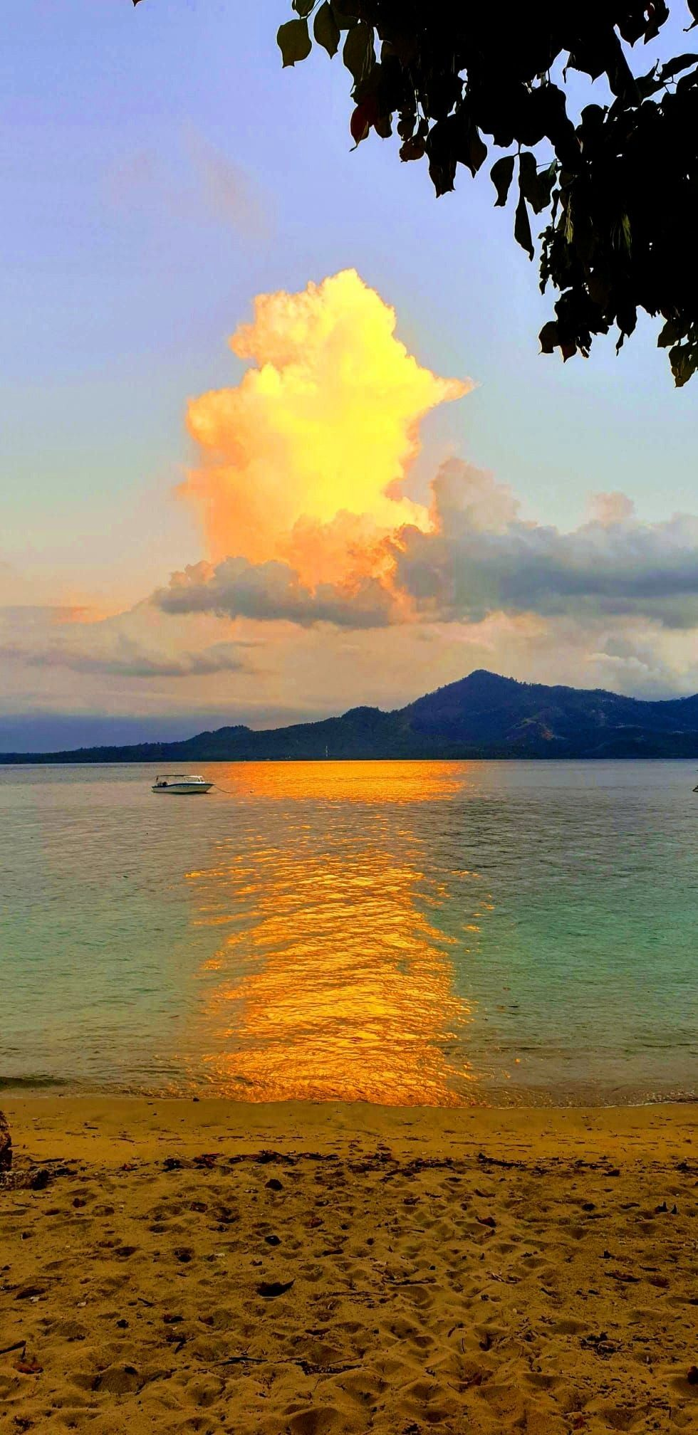 sky is painted in different colors every day when the sun sets over Siladen Island. A fantastic and