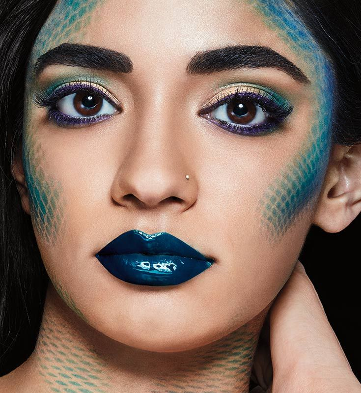 Learn How To Do A Mermaid Scales Makeup Look With Metallic Blue Lipstick Gold Eyeshadow Purp Mermaid Makeup Halloween Mermaid Makeup Tutorial Mermaid Makeup