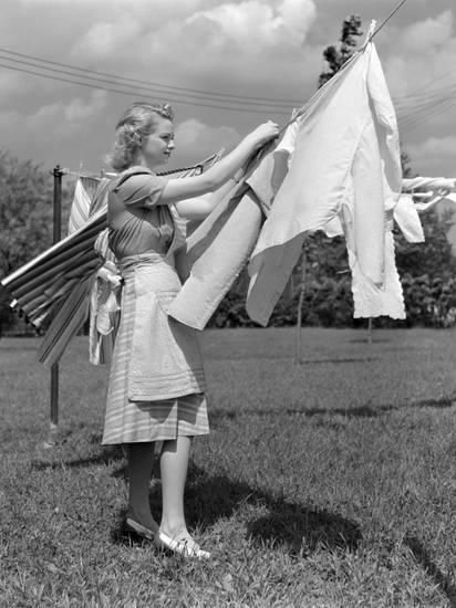 Woman Housewife Is Outdoors Hanging Clean Fresh Laundry On