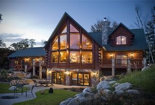 Exterior of Home with Columns, Wood log exterior, Wood decking, Firepit
