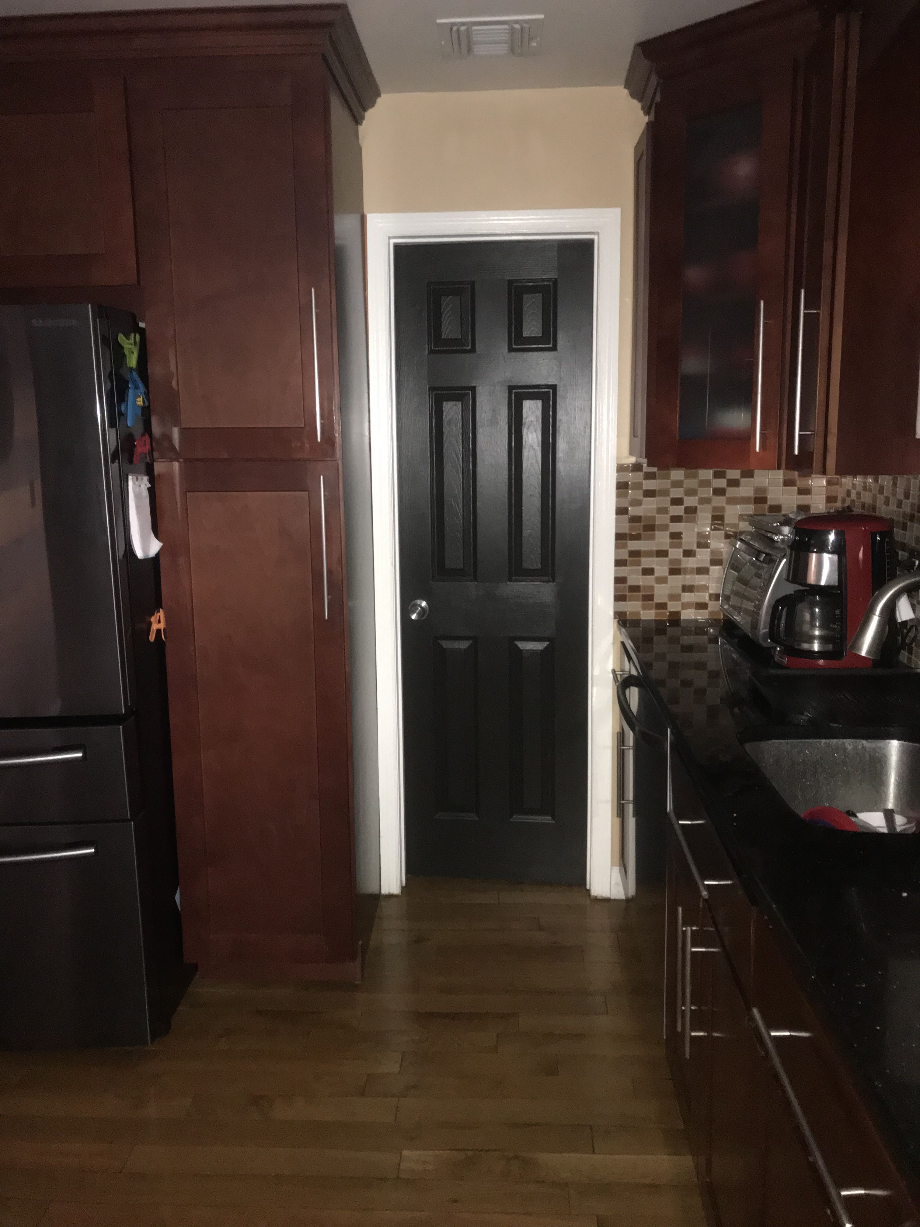 My Black Door In The Kitchen Used Behr Black Mocha Definitely Adds Richness And Modern Touch Black Doors Tall Cabinet Storage Kitchen
