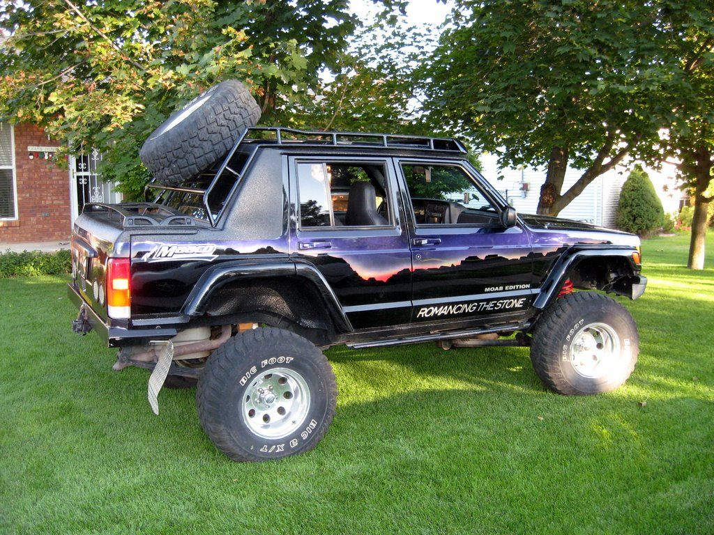 """It is a 1999 Jeep Cherokee with an 8"""" suspension lift, 33"""