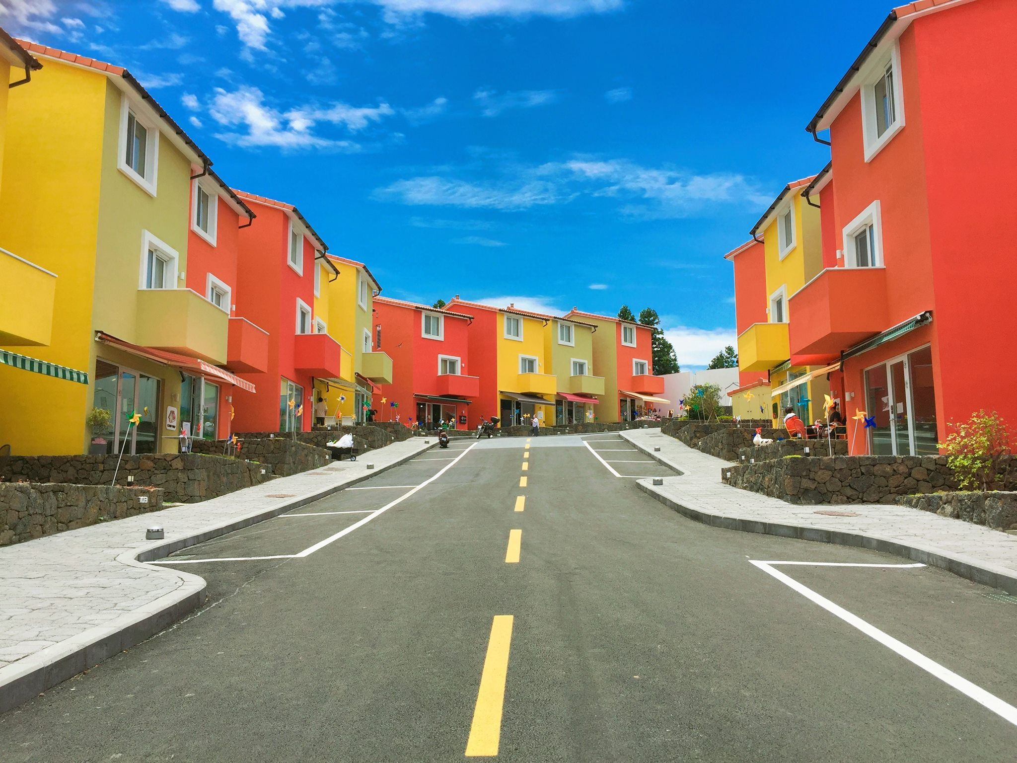 Dreaming of these technicolor homes nestled under fluffy