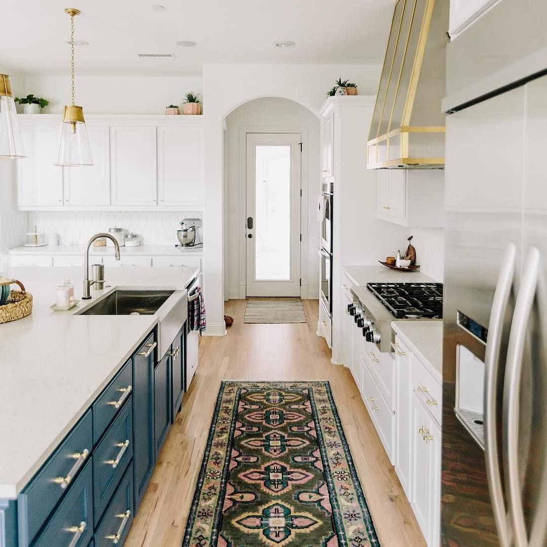 Teal Cabinets And Mixed Metals Add Depth And Color To Brns Design S Bright White Kitchen Featuring The Solna Kitchen Black Kitchens Kitchen Colors Red Kitchen