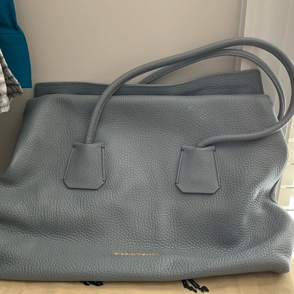 Burberry Tote Practically New!! Clean interior and exterior. Carried 2 or 3  times. Dust bag included. Burberry Bags Totes 4e4b231e7ebee