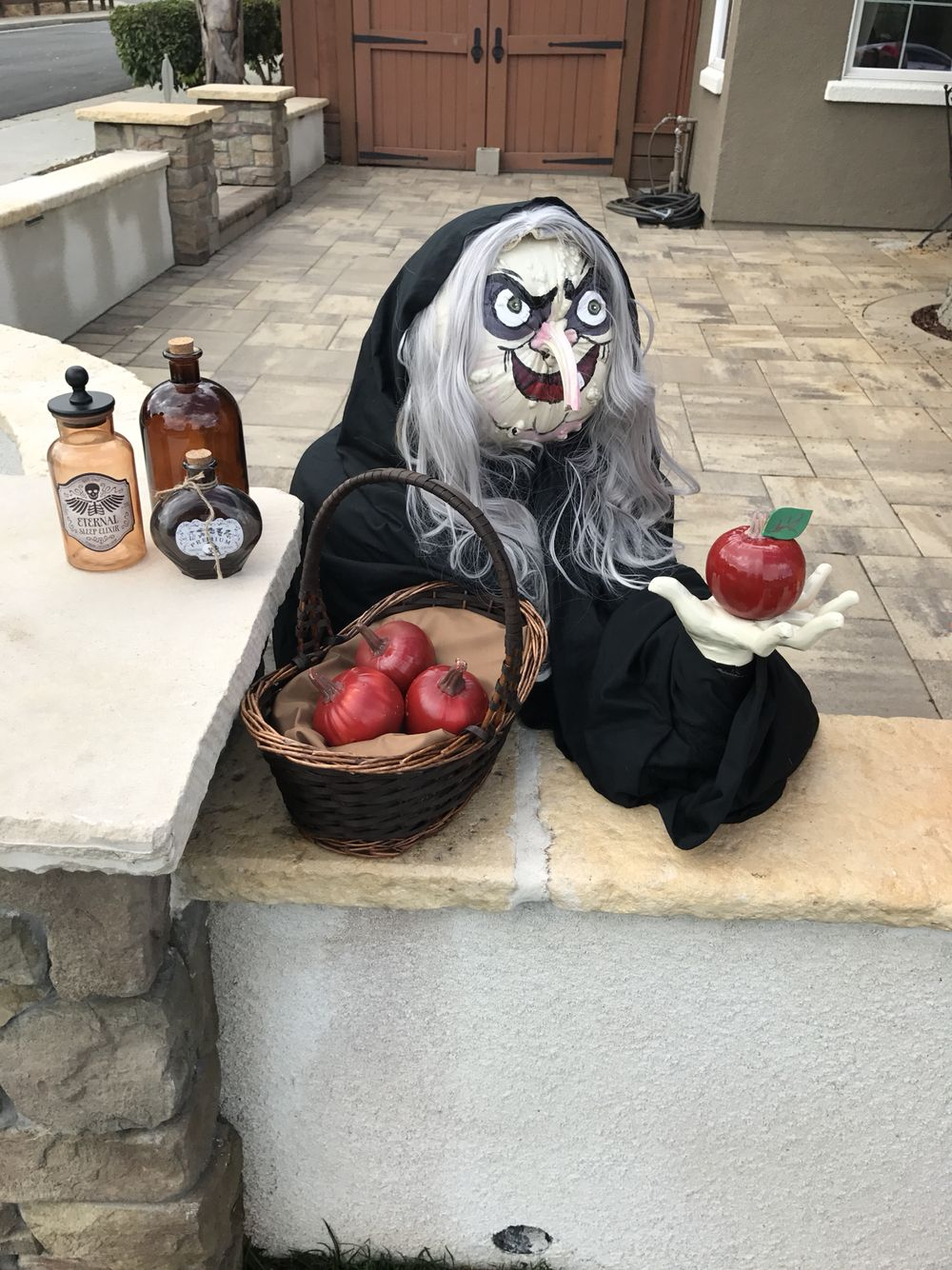 Wicked witch from Snow White created using a bumpy pumpkin with the