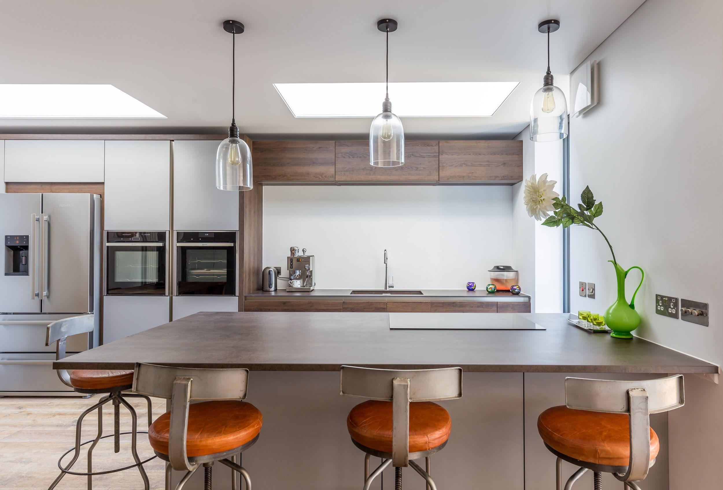Sleek contemporary kitchen | Modern kitchen island | industrial bar ...