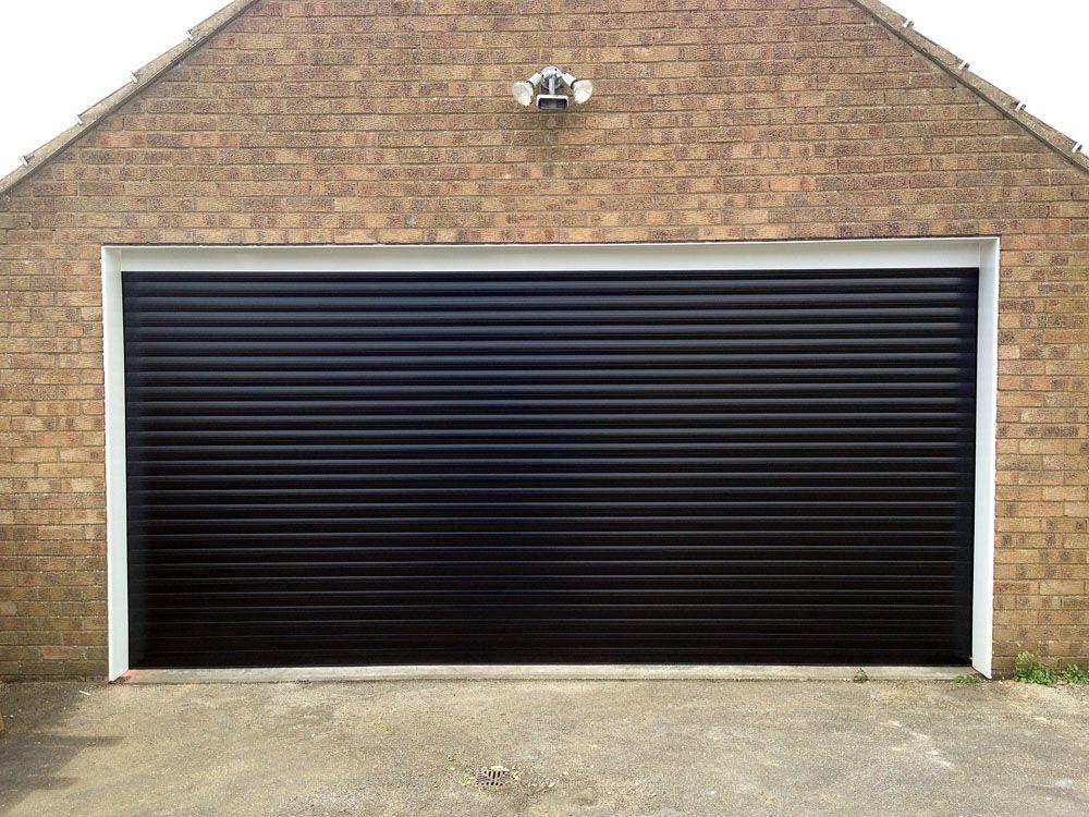 Black Roller Garage Door Installed In East Yorkshire By Swan Gates Garage Doors Door Installation Installation