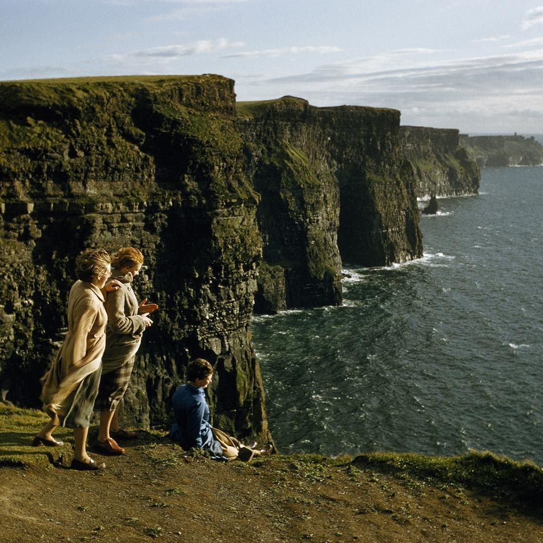 Insta / natgeocreative: Happy #StPatricksDay! Do you know what year this photo of women gazing out from the high edge of #CliffsofMoher by Volkmar K. Wentzel was published in National Geographic magazine? The answer will be posted in the caption. #TBT #ThrowbackThursday #Ireland