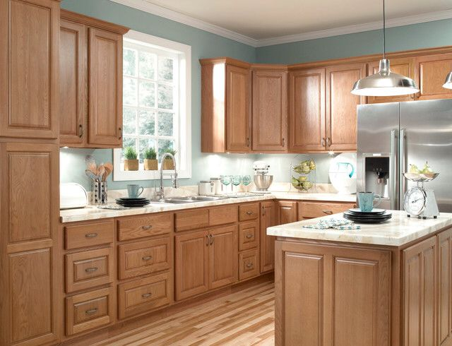 Pine Cabinets With Blue Painted Walls Wood Grain Flooring