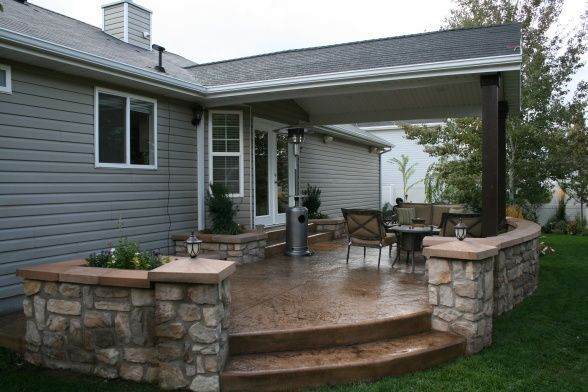 outdoor covered patio  covered stamped concrete patio with surrounding rock wall