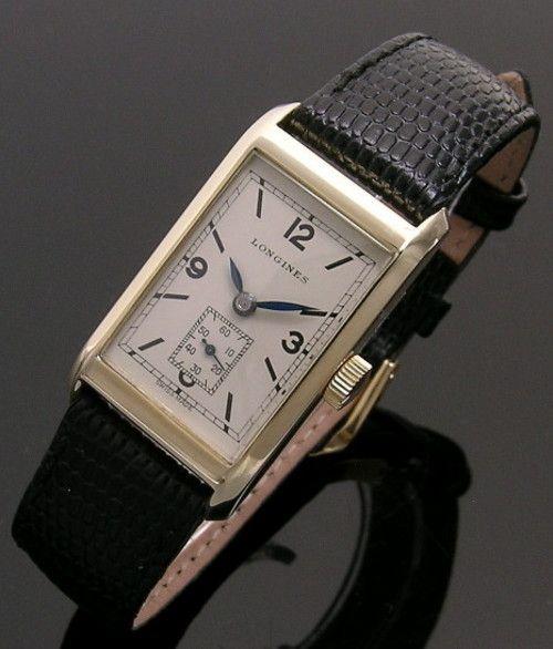 ae3f2f3c517 A 14ct gold rectangular vintage Longines watch