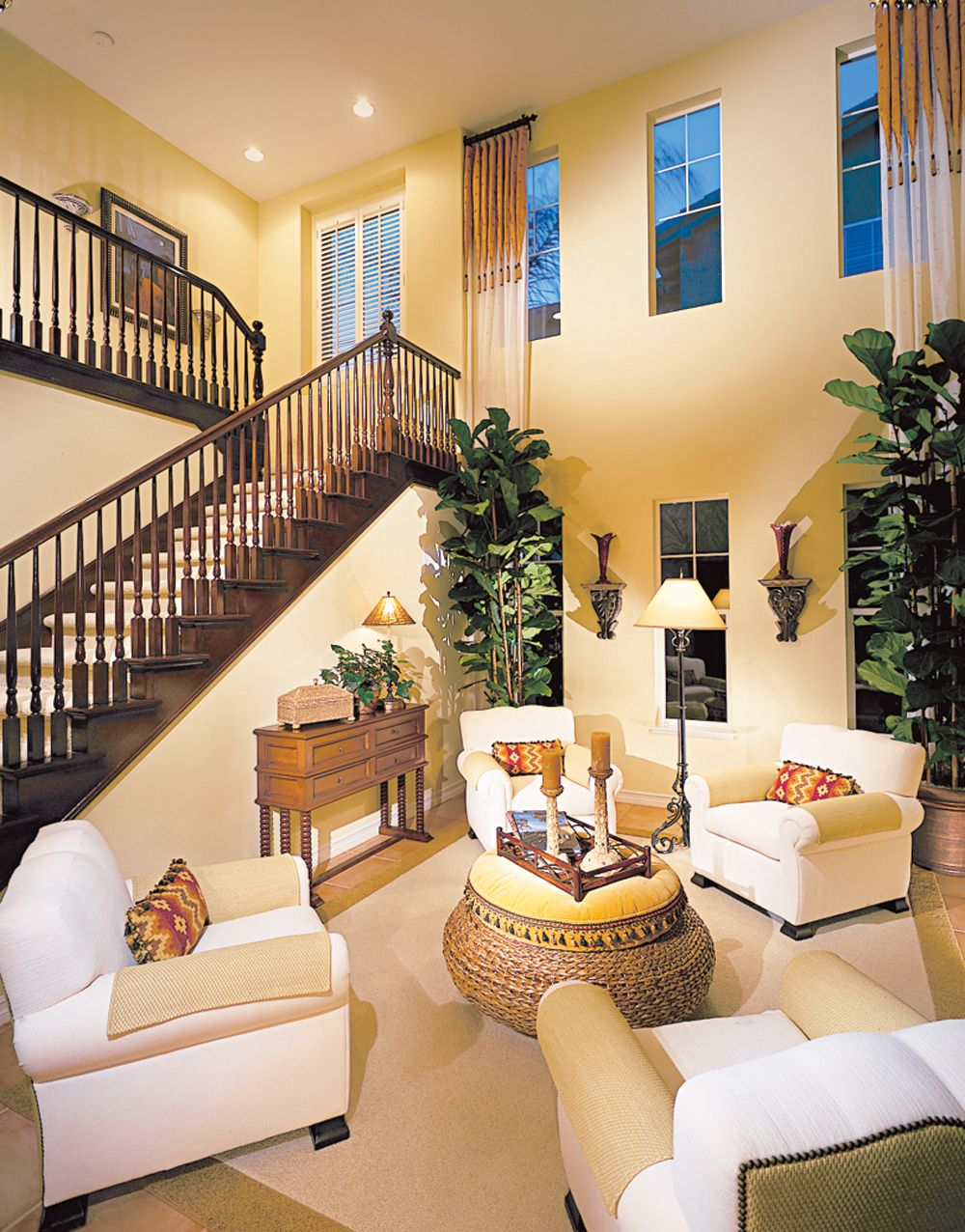 Photos of two story living rooms with stairs with Tall ceilings interior design