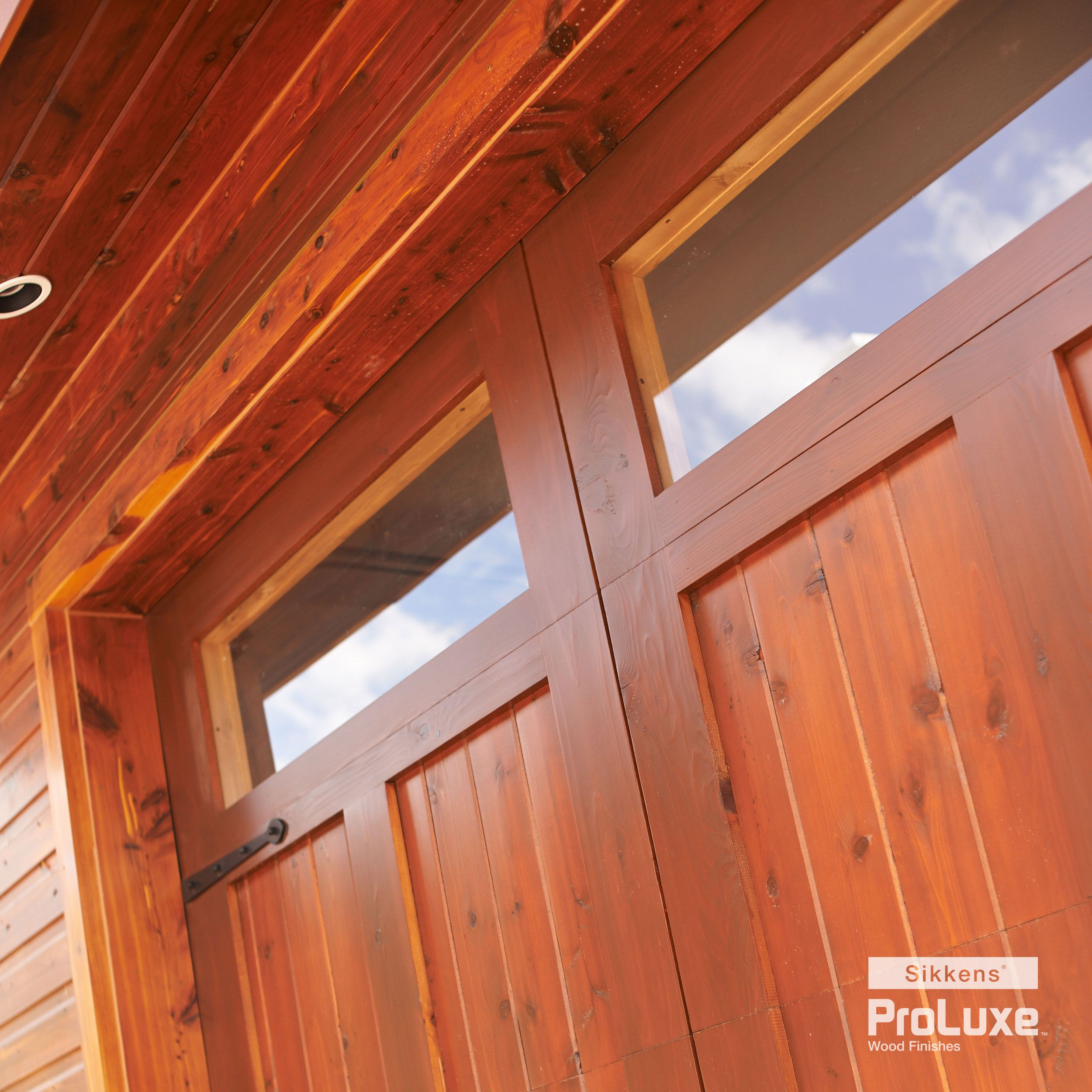 Irresistibly Flawless Finish (SIKKENS® PROLUXE™ Cetol® SRD In Redwood) On  Both. Garage DoorsStains