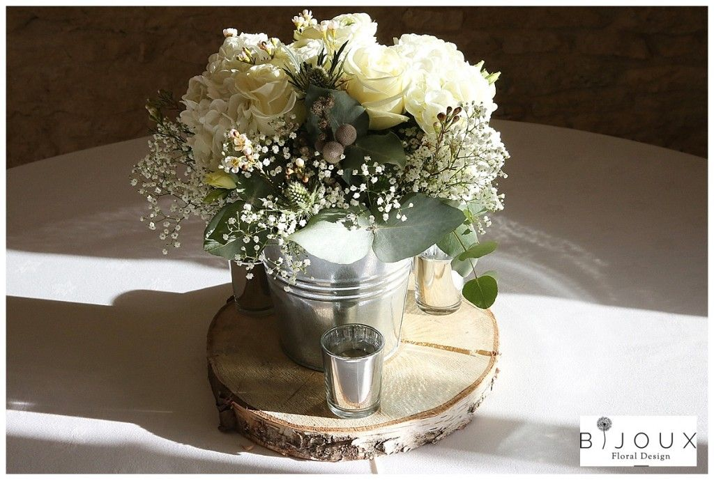 winter wedding table centres buckets filled with flowers rh pinterest co uk