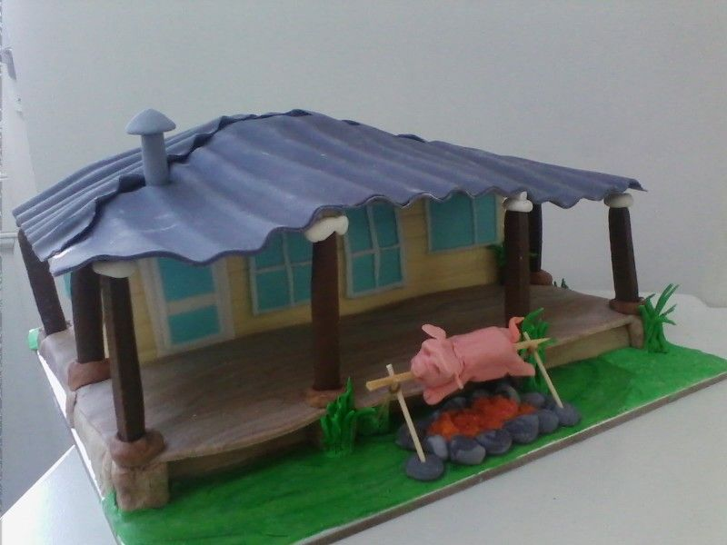 Fondant Cabin cake with pig on a spit, all edible!! Camp fire, outdoors themed birthday cake ideas!