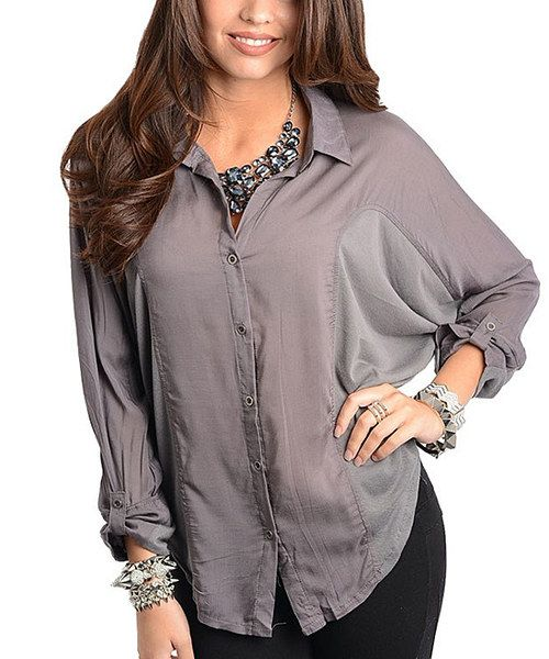 Flattering and fierce, this button-up is all about the dolman silhouette. Roll-up sleeves and a classic hue combine for a sleek piece that's ready to take on the day or night.100% polyesterHand washImported